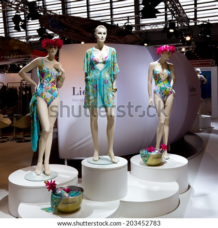PARIS, FRANCE - JULY 5, 2014: Mannequins showing beach wear are on display at Mode City, a swimwear and lingerie tradeshow where over 20,000 buyers meet 500 exhibitors from 35 different countries. - stock photo