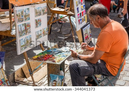 Paris, France-July 26, Paris Montmartre, street artist, July 26.2015 in Paris - stock photo