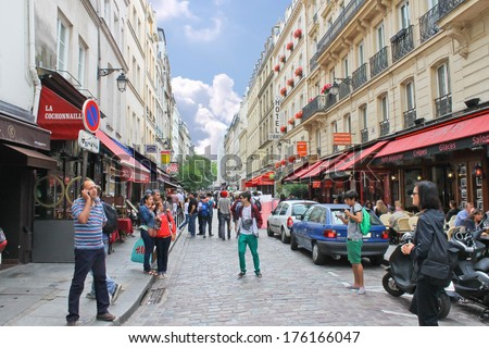 PARIS, FRANCE - JULY 10, 2012: People on the streets  in Paris, France. Paris is one of the most attractive tourist cities in the world - stock photo