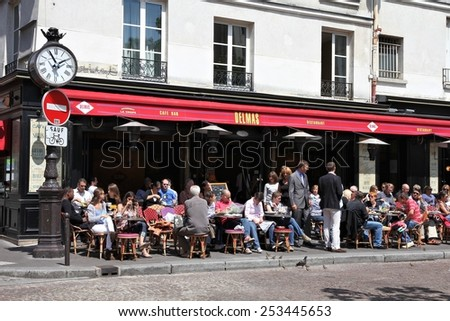 PARIS, FRANCE - JULY 20, 2011: People visit Cafe Delmas in Paris, France. Paris is the most visited city in the world with 15.6 million international arrivals in 2011. - stock photo