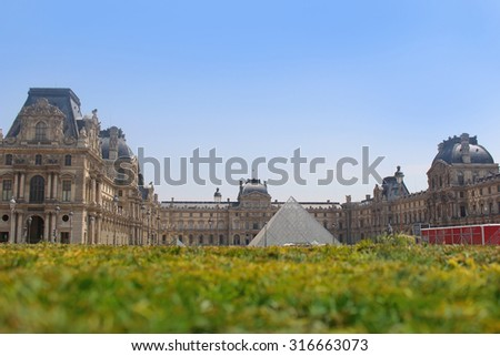 PARIS, FRANCE - JULY 4, 2015:  Shallow depth of field with focus on the pyramid of  the  Louvre Museum in Paris France on July 4, 2015 - stock photo