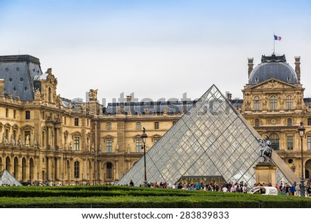 PARIS, FRANCE - JULY 14 2014: The Louvre is one of the world's largest museums and a historic monument in Paris, July 14, 2014 - stock photo
