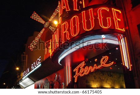 PARIS FRANCE - JULY 24: The Moulin Rouge by night July 24, 2009 in Paris, France. Moulin Rouge is a famous cabaret built in 1889, locating in the Paris red-light district of Pigalle - stock photo