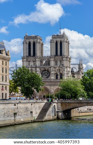 PARIS, FRANCE - JULY 14, 2012: View of Cathedral Notre Dame de Paris - a most famous Gothic, Roman Catholic cathedral (1163 - 1345) on the eastern half of the Cite Island - stock photo