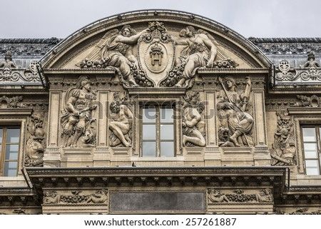 PARIS, FRANCE - JULY 14, 2014: View of Sculptures on the Louvre building in Louvre Museum. Museum is one of the largest and most visited museums worldwide. - stock photo