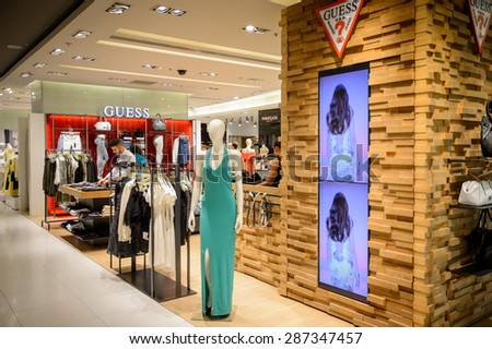 PARIS, FRANCE - JUN 6, 2015: Guess section in the Galeries Lafayette city mall. It was open in 1912 - stock photo