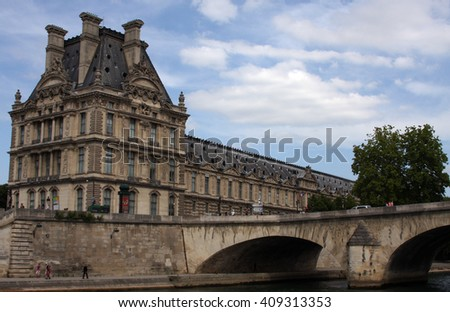 PARIS, FRANCE - JUNE 10, 2015: A view of the famous Louvre Museum from the Seine River. The Louvre Museum is one of the largest and most visited museums worldwide. - stock photo