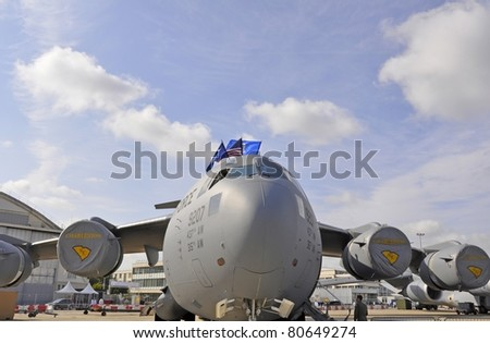 """PARIS, FRANCE - JUNE 24: Boeing  C-17A Globemaster III  on display at the world's largest and oldest aviation showcase """"The International Paris Air Show"""" on June 24, 2011 Le Bourget Airport, France. - stock photo"""