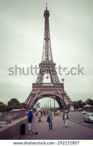 PARIS, FRANCE - JUNE 3: Eiffel Tower is the most visited monument in France and the most famous symbol of Paris, June 3, 2015, process color - stock photo