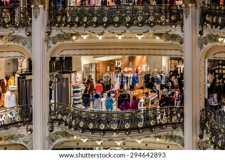 PARIS, FRANCE - JUNE 1, 2015: Interior of Galleries Lafayette Haussmann in Paris - Department Store (14000 sq. meters) with leading international collection (260 brands) of chic and bold. - stock photo