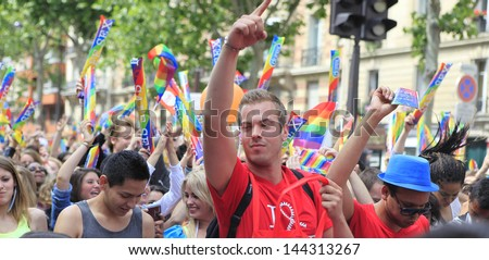 PARIS, FRANCE - JUNE 29 : Protesters marching for gay rights at The Gay Pride parade 2013 in Paris, France, June 29, 2013 - stock photo