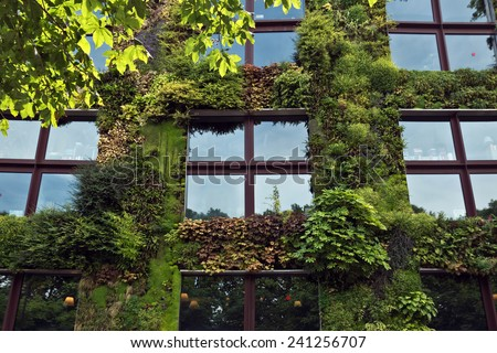 PARIS, FRANCE - JUNE 9: Quai Branly Museum. The green wall on part of the exterior of the museum was designed and planted by Gilles Clement and Patrick Blanc.  - stock photo