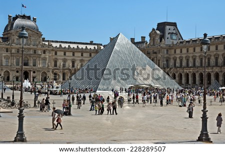 PARIS, FRANCE - JUNE 11, 2014: Square of Louvre Museum. Louvre is one of the biggest Museum in the world, receiving more than 8 million visitors each year.  - stock photo