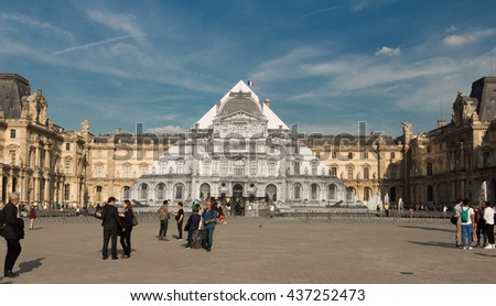 Paris, France-June 09, 2016 : The Louvre pyramid covered  with colossal black and white photos of the 16th century buildings surrounding the monument, making it appear as if it not there at all. - stock photo