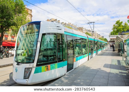 PARIS, FRANCE 2 JUNE 2014-- The tramway line T3 opened in Paris in December 2006. Managed by the RATP, it follows the Boulevards des Marechaux, encircling Paris. - stock photo
