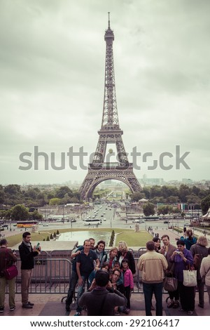 PARIS, FRANCE - JUNE 5 :Tourist Photography with Eiffel Tower is the most visited monument in France and the most famous symbol of Paris, June 5, 2015 - stock photo