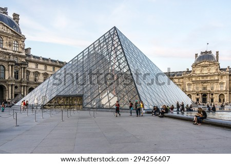 PARIS, FRANCE - JUNE 10, 2015: View of famous Louvre Museum at evening. Louvre Museum is one of the largest and most visited museums worldwide. - stock photo