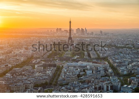 Paris, France landmarks - Aerial view of Paris skyline at sunset in Paris, France. Paris is capital city of France. Eiffel Tower is a wrought iron lattice tower on the Champ de Mars in Paris, France. - stock photo