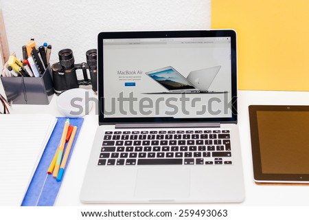 PARIS, FRANCE - MAR 10, 2015: Apple Computers website on MacBook Retina in room environment showcasing MacBook Air as seen on 10 March, 2015 - stock photo