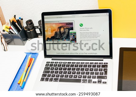 PARIS, FRANCE - MAR 10, 2015: Apple Computers website on MacBook Retina in room environment showcasing Answer iPhone calls from your Mac as seen on 10 March, 2015 - stock photo