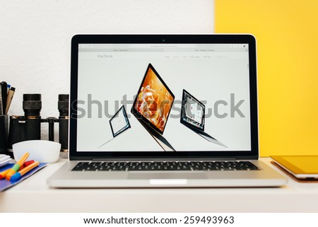 PARIS, FRANCE - MAR 10, 2015: Apple Computers website on MacBook Retina in room environment showcasing new MacBook colors as seen on 10 March, 2015 - stock photo