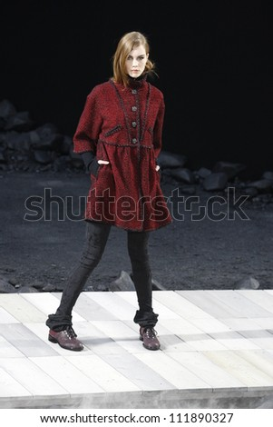 PARIS, FRANCE - MARCH 08: A model walks the runway during the Chanel Ready to Wear Autumn/Winter 2011/2012 show during Paris Fashion Week at Grand Palais on March 8, 2011 in Paris, France. - stock photo