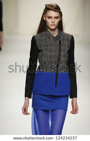 PARIS, FRANCE - MARCH 07: A model walks the runway during the Comuun Ready to Wear Autumn/Winter 2011/2012 show during Paris Fashion Week on March 7, 2011 in Paris, France - stock photo