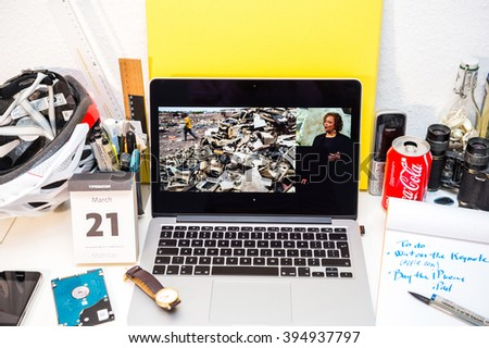PARIS, FRANCE - MARCH 21, 2016: Apple Computers website on MacBook Pro Retina in a creative room environment showcasing Apple Event with Lisa Jackson presenting a typical dump waste - stock photo