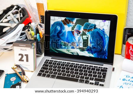 PARIS, FRANCE - MARCH 21, 2016: Apple Computers website on MacBook Pro Retina in a creative room showcasing Apple Event with Apple COO Jeff Williams and Care Kit presentation in hospital environment - stock photo
