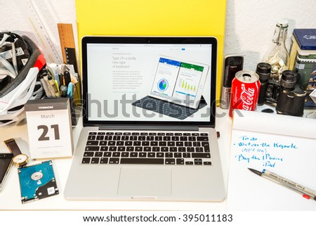 PARIS, FRANCE - MARCH 21, 2016: Apple Computers website on MacBook Pro Retina in a geek creative room environment showcasing the newly announced iPad Pro and its new keyboard - stock photo