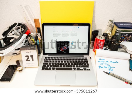 PARIS, FRANCE - MARCH 21, 2016: Apple Computers website on MacBook Pro Retina in a geek creative room environment showcasing the newly announced iPad pro and its GPU - stock photo