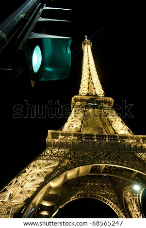 PARIS, FRANCE - MARCH 17: Ceremonial lighting of the Eiffel tower with traffic lights on March 17, 2010 in Paris, France. The tower stands 324 metres (1,063 ft) tall - stock photo