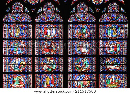 PARIS, FRANCE - MARCH 12, 2014: Famous Notre Dame cathedral stained glass. UNESCO World Heritage Site. Paris, France on March 12, 2014 - stock photo