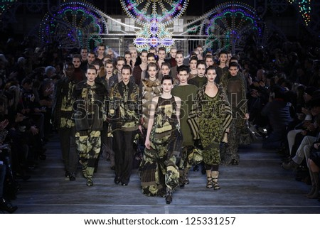 PARIS, FRANCE - MARCH 06: Models walk the runway at the Kenzo fashion show during Paris Fashion Week on March 6, 2011 in Paris, France. - stock photo