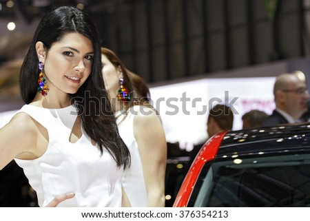 Paris, France - March 2nd: Beautiful hostess by the car on Geneva Motor Show on March 2nd, 2010 in Geneva. - stock photo