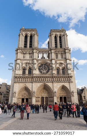 PARIS, FRANCE - MARCH 31, 2015: People in front of Notre Dame, Famous Catholic Church, Tourism Landmark on March 31, 2015 in Paris France - stock photo