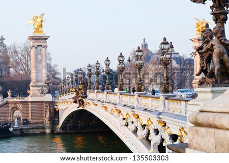 PARIS, FRANCE - MARCH 4: Pont Alexandre III. The bridge, with its Art Nouveau lamps, cherubs, nymphs and winged horses at either end, was built between 1896 and 1900, in Paris, France on March 4, 2013 - stock photo