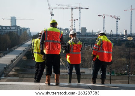 """PARIS - France 23 March 2015 workers in construction site in """"La defense"""" - stock photo"""
