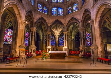 PARIS, FRANCE - MAY 31, 2016 Altar Cross Column Shape of Palm Tree Stained Glass Saint Severin Church Paris France.  Saint Severin built in the 1500s - stock photo