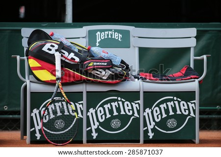 PARIS, FRANCE- MAY 30, 2015: Babolat Aero Pro racquet and Babolat bag at Le Stade Roland Garros in Paris, France. Babolat is an Official Partner of the tournament and provides racquets, balls, strings - stock photo