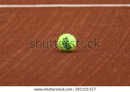 PARIS, FRANCE- MAY 23, 2015: Babolat Roland Garros 2015 tennis ball  at Le Stade Roland Garros in Paris, France. Babolat is an Official Partner of the tournament and provides racquets, balls, strings - stock photo
