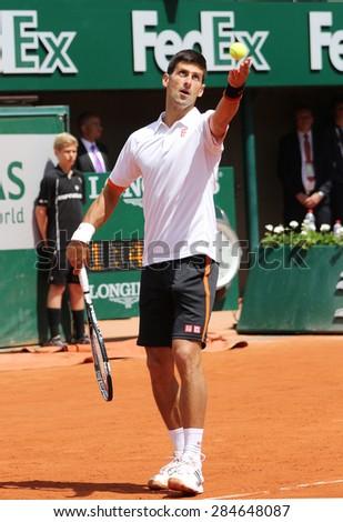 PARIS, FRANCE- MAY 30, 2015: Eight times Grand Slam champion Novak Djokovic during third round match at Roland Garros 2015 in Paris, France - stock photo