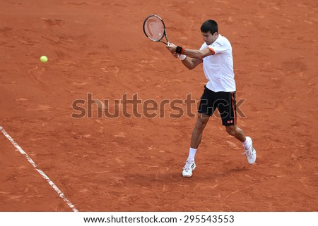 PARIS, FRANCE- MAY 30, 2015: Eight times Grand Slam champion Novak Djokovic in action during his third round match at Roland Garros 2015 in Paris, France - stock photo