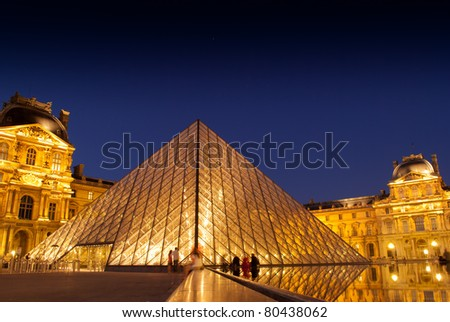 PARIS,FRANCE - MAY 29: Entry to Louvre Museum on May 29, 2011 in Paris. The large pyramid was completed in 1989, it has become a landmark of the city of Paris. - stock photo