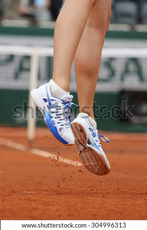 PARIS, FRANCE- MAY 29, 2015:Five times Grand Slam champion Maria Sharapova wears custom Nike shoes during third round match at Roland Garros 2015 in Paris, France - stock photo