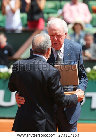 PARIS, FRANCE- MAY 30, 2015: Former tennis champion Fred Stolle, of Australia, received a symbolic trophy, just 50 years after winning the French Open tennis tournament, at the Roland Garros stadium - stock photo