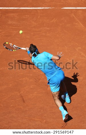 PARIS, FRANCE- MAY 30, 2015:Fourteen times Grand Slam champion Rafael Nadal in action during his third round match at Roland Garros 2015 in Paris, France - stock photo