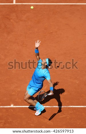 PARIS, FRANCE- MAY 30, 2015: Fourteen times Grand Slam champion Rafael Nadal in action during his third round match at Roland Garros 2015 in Paris, France - stock photo