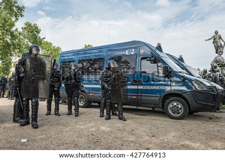Paris, FRANCE - MAY 26, 2016 : French police, anti-riot squad, monitoring crowd to contain people during the massive protest over the labor law reforms. - stock photo
