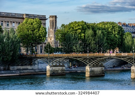 PARIS, FRANCE - MAY 30, 2015: Lockers at Pont des Arts (Passerelle des Art) symbolize love for ever. From 2008 to June 1, 2015, over a million locks were placed, weighing approximately 45 tons. - stock photo